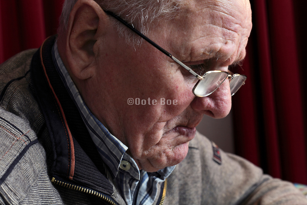 portrait of 89 year old man while reading