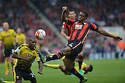 AFC Bournemouth's defender Sylvain Distin clears the ball during the Barclays Premier League match between Bournemouth and Watford at the Goldsands Stadium, Bournemouth, England on 3 October 2015. Photo by Mark Davies.