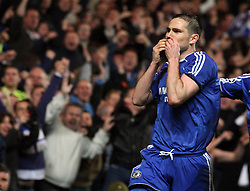 Frank Lampard of Chelsea kisses a black armband in memory of his mother as he celebrates after scoring a penalty to make it 2-1