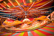 Oct. 21, 2009 -- PHOENIX, AZ: A ride on the midway at the Arizona State Fair in Phoenix, AZ. The fair runs through November 8.   Photo by Jack Kurtz