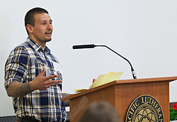 Josh Cushman '08, speaks at the Celebration of Service at PLU on Wednesday, April 22, 2015. (Photo: John Froschauer/PLU)