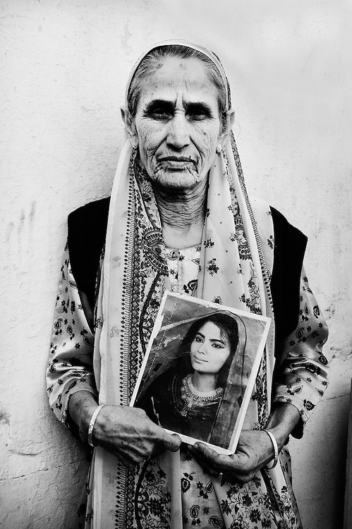 Shakti Shalini initiates effective action against dowry-related crimes. One of Shakti Shalini's co-founders and  president Shah Jahan Begum holds a picture of her daughter who was burnt to death by her in-laws.