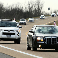 Adam Robison | BUY AT PHOTOS.DJOURNAL.COM<br /> A Motorcade make its way north on Highway 45 on their way to St. Paul United Methodist Church in Tupelo for the Dr. Martin Luther King Jr. Birthday celebration in Tupelo Monday morning.