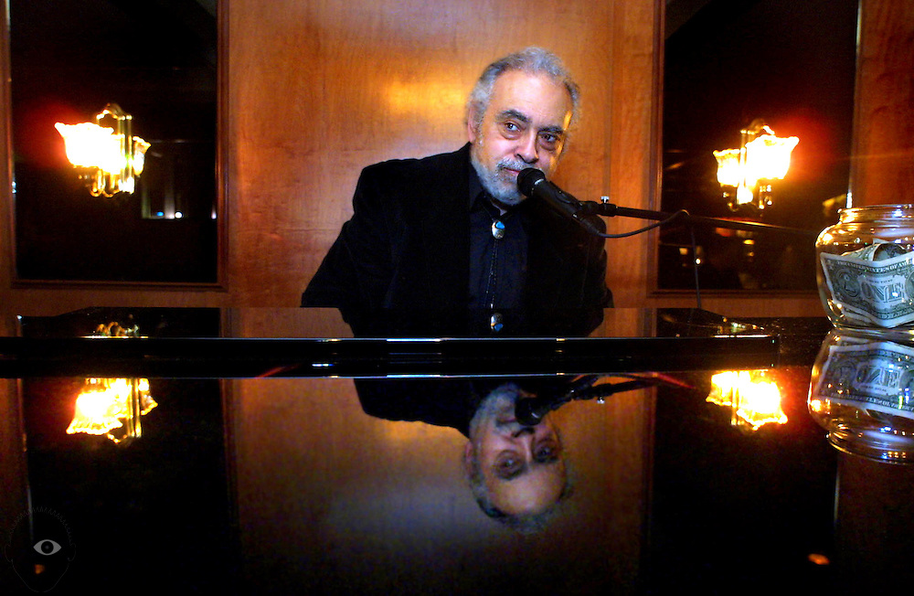 Marty Tocci entertains the crowd about the piano bar which opened about a month ago inside the Prime Rib Restaurant and Lounge.