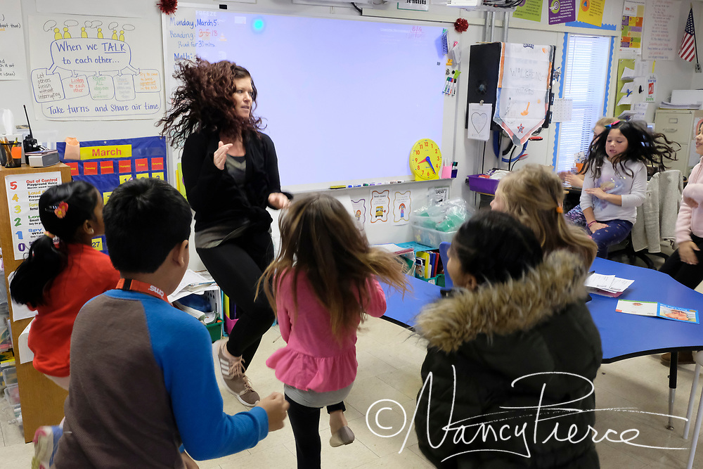 """Kelly Ludwick, Teacher Assistant of the Year at Elon Park ES, for South LC. Here she leads students in a short """"sensory break"""" ."""