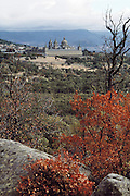 El Escorial, Spain, seen from a rocky hillside.