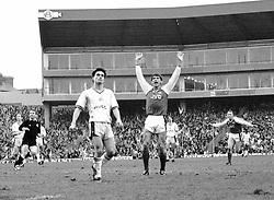 Arsenal striker Alan Smith (centre) celebrates scoring his second goal at Highbury. Dejected West Ham United player Steve Potts (l) looks on.