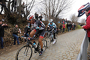 Belgium, March 31 2013: RADIOSHACK-LEOPARD rider, Fabian Cancellara, is followed by Michal Kwiatkowski, OMEGA PHARMA-QUICK STEP, up the final climb of the Oude-Kwaremont during the elite men's Ronde van Vlaandaren 2013. Copyright 2013 Peter Horrell.