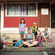 Desarae Mann, 7, rests her head on her mom, April's leg, next to her sister, Ariana Mann, 8, left. Also with the Manns are siblings, Kam'ryn, 5, and Kaliyah Stouffer, 8 in downtown Smithsburg, Maryland, on Tuesday, September 26, 2017. Smithsburg is a very different town than the southern part of the district that includes Potomac and Germantown. Originally a District that was mostly rural, but included big towns like Frederick Hagerstown, along with smaller ones like Smithsburg, Maryland's 6th District was redistricted in 2011, combining rural northern Maryland regions with more affluent communities like near Washington D.C. turning the district from Republican to Democrat. <br />