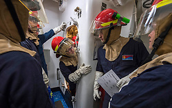 EAST CHINA SEA (Aug. 21, 2018) Sailors relay messages for a simulated flooding during a damage control training team drill aboard the Arleigh Burke-class guided-missile destroyer USS Benfold (DDG 65). Benfold is forward-deployed to the U.S. 7th Fleet area of operations in support of security and stability in the Indo-Pacific region. (U.S. Navy photo by Mass Communication Specialist 2nd Class Elesia Patten/Released)180821-N-WM647-1079