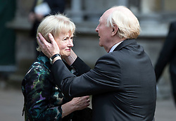 © Licensed to London News Pictures. 20/06/2016. London, UK. NEIL KINNOCK embraces his wife GLENYS KINNOCK as they leave St Margaret's Church, Westminster Abbey after taking part in a Service of Prayer and Remembrance to commemorate Jo Cox MP, who was killed in her constituency on June 16, 2016. Photo credit: Peter Macdiarmid/LNP