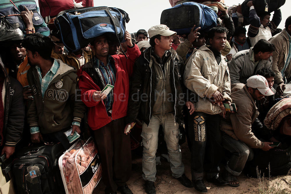 After leaving Libya, thousand of Bengladesh migrant workers arrive at an UNHCR transit camp in Choucha, 7 km from Tunisia's Ras Jedir border station.<br /> 04 March 2011.
