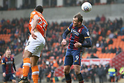 Blackpool midfielder Colin Daniel (23) and Bradford City striker Charlie Wyke (9) during the EFL Sky Bet League 1 match between Blackpool and Bradford City at Bloomfield Road, Blackpool, England on 7 April 2018. Picture by Craig Galloway.