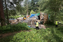 © Licensed to London News Pictures. 23/06/2017. Dorking, UK. Workers dismantle a protest fort built over an oil well site near Leith Hill in the North Downs . Protestors have been evicted from the camp over the last few days. Planning permission for 18 weeks of exploratory drilling was granted to Europa Oil and Gas in August 2015 after a four-year planning battle. The camp was set up by protestors in October 2016 in order to draw attention to plans to drill in this Area of Outstanding Natural Beauty (AONB) in the Surrey Hills. The camp has received support from the local community. Photo credit: Peter Macdiarmid/LNP