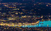 Jet d´Eau in Geneva, Switzerland is painted with blue lights in celebration of Europe day 2015 as viewed from the mountain Saleve in France.