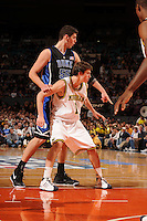 Duke center Brian Zoubek #55 and Michigan guard Stu Douglass #1 as the Duke Blue Devils beat the Michigan Wolverines, 71-56, to win the championship of the 2K Sports Classic benefiting Coaches vs. Cancer on Friday November 21 at Madison Square Garden.
