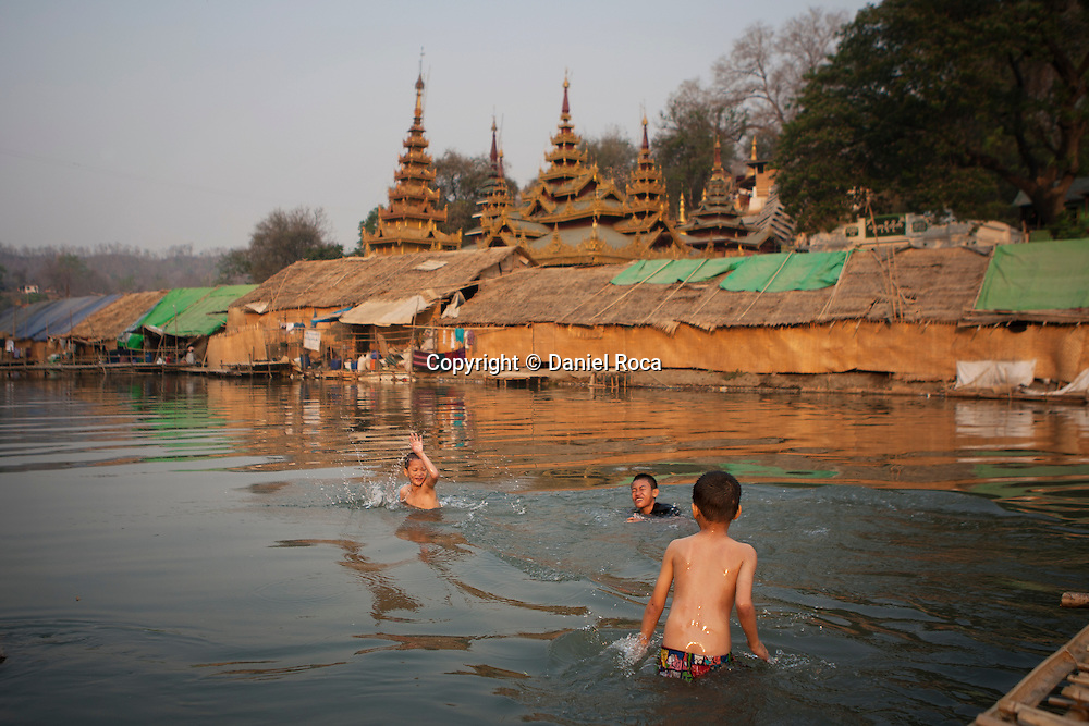 Children enjoying a bath next to the Temple of Buddha&rsquo;s footprint. Shwet Set Taw, Magwai<br />