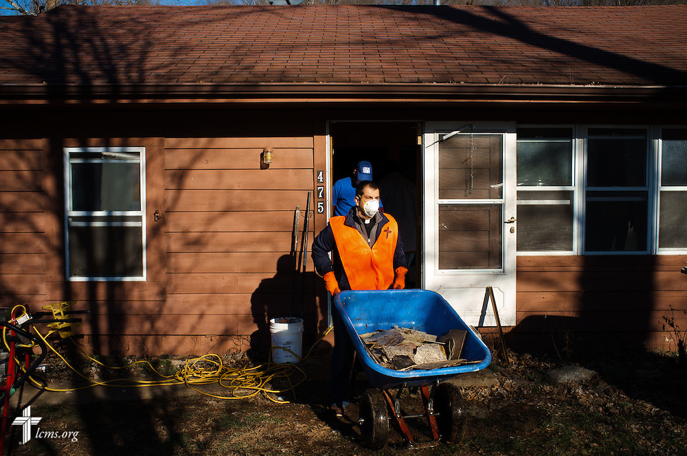 The Rev. Ross Johnson, director of LCMS Disaster Response, helps with other volunteers from the International Center of The Lutheran Church–Missouri Synod, New Beginnings Lutheran Church in Pacific, Mo., and Missouri representatives of the Southern Baptist Convention Disaster Relief, during a cleaning event at a flooded home in Fenton on Thursday, Jan. 14, 2016. LCMS Communications/Erik M. Lunsford
