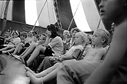 Crowd watching a circus performance, Ashton Court Festival, Bristol, UK, 1995.
