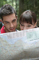 Couple observing map outdoors close-up