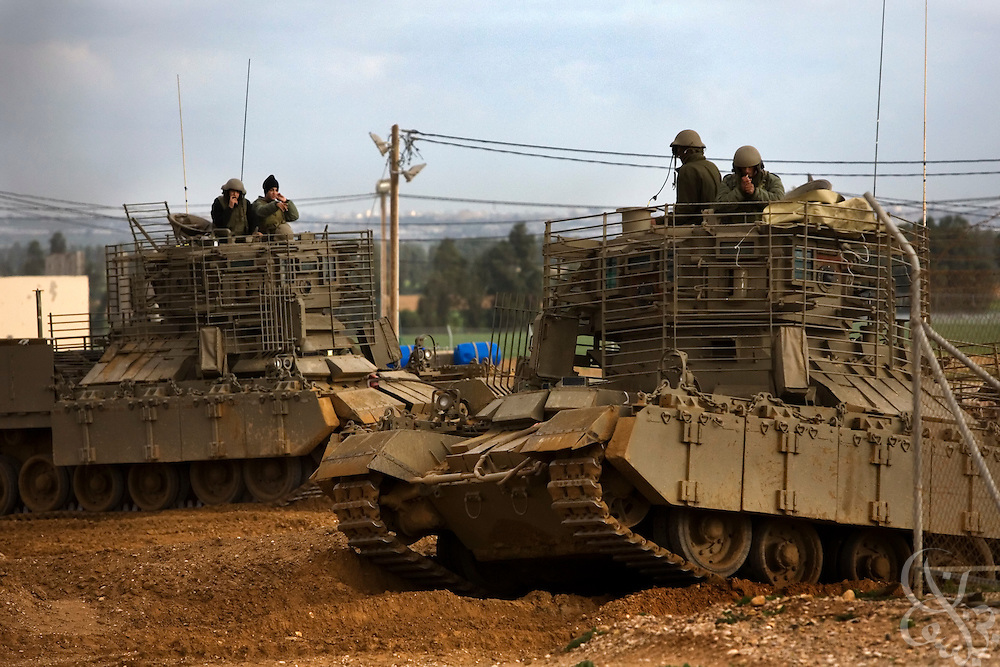 Israeli Defense Force (IDF) armored personnel carriers return from a mission to their base near the Israeli-Gaza border during the ongoing Operation Cast Lead January 8, 2009 at the Sufa Crossing. The operation has entered its 13th day, despite truce efforts from a host of nations including France, Egypt and the United States.