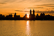 View of Central Park West, Upper West Side of Manhattan from the Jacqueline Kennedy Onassis Reservoir in Central Park, New York City.