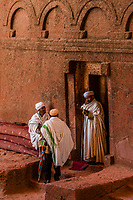 Priests outside Debre Sina Mikael (Church of St. Michael), one of 11 rock hewn medieval monolithic churches in  Lalibela, Ethiopia.
