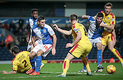 Lee Frecklington (captain) (Rotherham United) turns to get to the ball ahead of the Blackburn players during the Sky Bet Championship match between Blackburn Rovers and Rotherham United at Ewood Park, Blackburn, England on 11 December 2015. Photo by Mark P Doherty.
