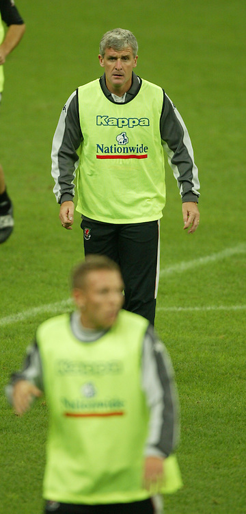 MILAN, ITALY - Thursday, September 4, 2003: Wales' manager Mark Hughes with Craig Bellamy in the forground training at the San Siro ahead of their Group 9 Euro 2004 qualifier against Italy. (Pic by David Rawcliffe/Propaganda)