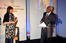 CATH KIDSTON and SIR TREVOR MACDONALD at the presentation of the Veuve Clicquot Business Woman Award 2009 hosted by Graham Boyes MD Moet Hennessy UK and presented by Sir Trevor Macdonald at The Saatchi Gallery, Duke of York's Square, Kings Road, London SW1 on 28th April 2009.