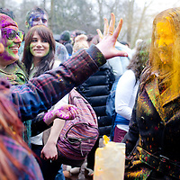 London, UK - 23 March 2013: a woman throws colored powder on the  face of her friend during the Holi Spring Festival of Colour takes place at Orleans House Gallery in Twickenham. The annual event marks the end of Winter and welcomes the joy of spring.