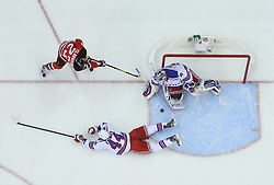 May 21, 2012; Newark, NJ, USA; New York Rangers goalie Henrik Lundqvist (30) makes a save on New Jersey Devils right wing David Clarkson (23) during the first period in game four of the 2012 Eastern Conference Finals at the Prudential Center.  The Devils defeated the Rangers 4-1.