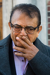© Licensed to London News Pictures. 09/10/2015. London, UK. An emotional Vinod Hindocha, Anni Dewani's father, listens to a statement being ready out to media after leaving North London Coroner's Court in Barnet, north London where a Coroner ruled there will be no inquest into murdered honeymoon bride Anni Dewani. Photo credit: Ben Cawthra/LNP