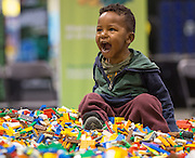 Mikeal Hnderson, age 2, can't contain his excitement on top of a giant mountain of LEGO bricks during LEGO KidsFest at the BMO Centre in Calgary on Friday May 16, 2014. (Jenn Pierce/Calgary Herald)