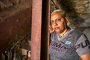 "Semara Garcia Gutierrez, 43, is currently serving a three year prison sentence in Matanzas but was photographed while on weekend leave visiting her mother in Old Havana. ""I took the fall for a friend during a street knife fight,"" she explains. ""Prison conditions aren't too bad.There are problems with food and water but everyone has their own bed and the guards are usually kind,"" she says. She is enrolled in a cooking course in the prison and dreams of one day sharing a home with her female partner and working as a chef.  ""Homosexuality is not accepted here in Cuba but people are becoming more open,"" she says. ""My mother and grandmother have always accepted me,"" she adds. Of Cuban women she says ""we are strong, beautiful and able to face anything because we've gone through so much already."""