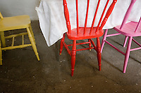 Multicoloured chairs in traditional cafe interior in Connemara Galway Ireland
