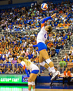 Mackenzie Dagostino serves during the first set against rival FSU. (photo by Samuel Navarro)