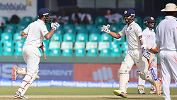 August 3, 2017 - Colombo, Sri Lanka - Indian cricketer ..Cheteshwar Pujara(L)  and Ajinkya Rahane celebrate as Cheteshwar Pujara scores 100 runs  during the 1st Day's play in the 2nd Test match between Sri Lanka and India at the SSC international cricket stadium at the capital city of Colombo, Sri Lanka on Thursday 03 August 2017. (Credit Image: © Tharaka Basnayaka/NurPhoto via ZUMA Press)