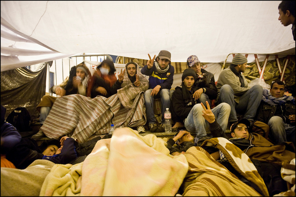 """Protesters of the 'Caravan of Freedom' continue their sit-in on the Kasbah square in Tunis, Tunisia on January 27, 2011. Protesters said they will continue their sit-in until the fall of the interim Government and satisfaction of their demands for decent life. Copyright Benjamin Girette /// On january the 14th 2011, Zine el-Abidine Ben Ali President of Tunisia and his famous wife Leila Trabelsi as know as """"The regent of Carthage"""" are forced by thousands of protesters to escape the country after 24 years of power. As a result a new democraty is in design for the next six months until Tunisians organize national democratic elections, it might be the birth of the first democraty in the arab world.."""