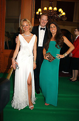 Left to right, the EARL & COUNTESS OF DERBY and ELISABETH SALTZMAN  at the NSPCC's Dream Auction held at The Royal Albert Hall, London on 9th May 2006.<br />
