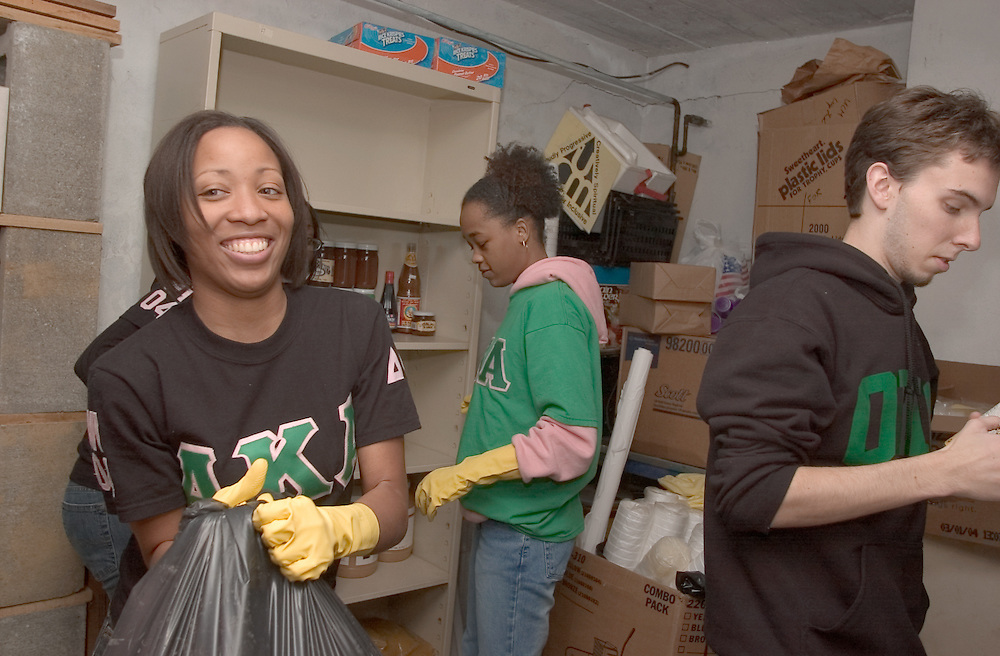 16834Martin Luther King Jr. Day of Service : UCM: Students...Tiffany N. Romine(left), Shawna Derrington(middle), from Alpha Kappa Alpha Sorority,  Inc., and Ben Palmer help get the UCM ready for a supper this week