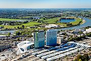Nederland, Gelderland, Arnhem, 30-09-2015; Arnhem centraal, Station Arnhem. Het nieuwe stationsgebouw (architect  UNStudio, Ben van Berkel), inclusief nieuwe perron overkappingen. Naast de OV terminal met busstation twee kantoorgebouwen, de Parktoren van ATOS en WTC Arnhem Nijmegen. Nederrijn en Meinerswijk in de achtergond.<br /> The new Arnhem Central Station.<br /> luchtfoto (toeslag op standard tarieven);<br /> aerial photo (additional fee required);<br /> copyright foto/photo Siebe Swart