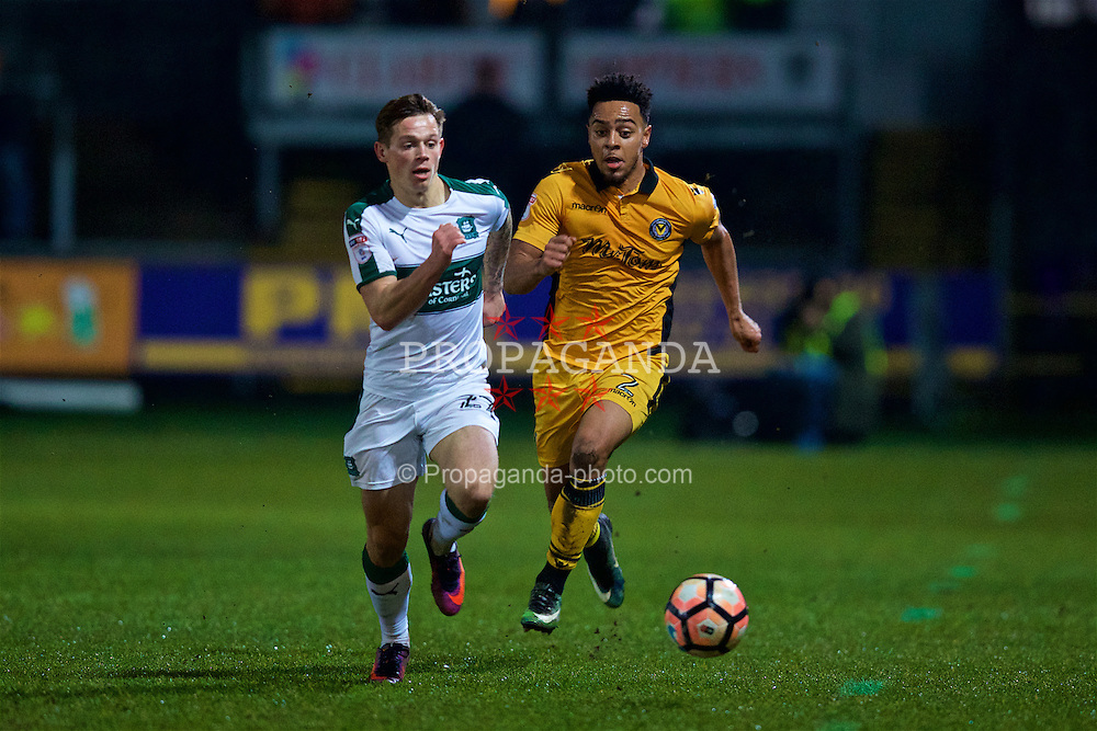 NEWPORT, WALES - Wednesday, December 21, 2016: Newport County's Jazzi Barnum-Bobb and Plymouth Argyle's Craig Tanner during the FA Cup 2nd Round Replay match at Rodney Parade. (Pic by David Rawcliffe/Propaganda)