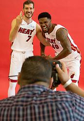 September 25, 2017 - Miami, Florida, U.S. - Miami Heat guard Goran Dragic (7) and Miami Heat forward Udonis Haslem (40) pose for Miami Herald photographer David Santiago during at Media Day at AmericanAirlines Arena in Miami, Florida on September 25, 2017. (Credit Image: © Allen Eyestone/The Palm Beach Post via ZUMA Wire)
