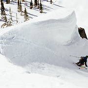 Griffin Post cornice sliding his way back to basecamp in Glacier National Park.
