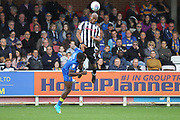 Calvin Andrew wins a header  during the EFL Sky Bet League 1 match between AFC Wimbledon and Rochdale at the Cherry Red Records Stadium, Kingston, England on 30 September 2017. Photo by Daniel Youngs.