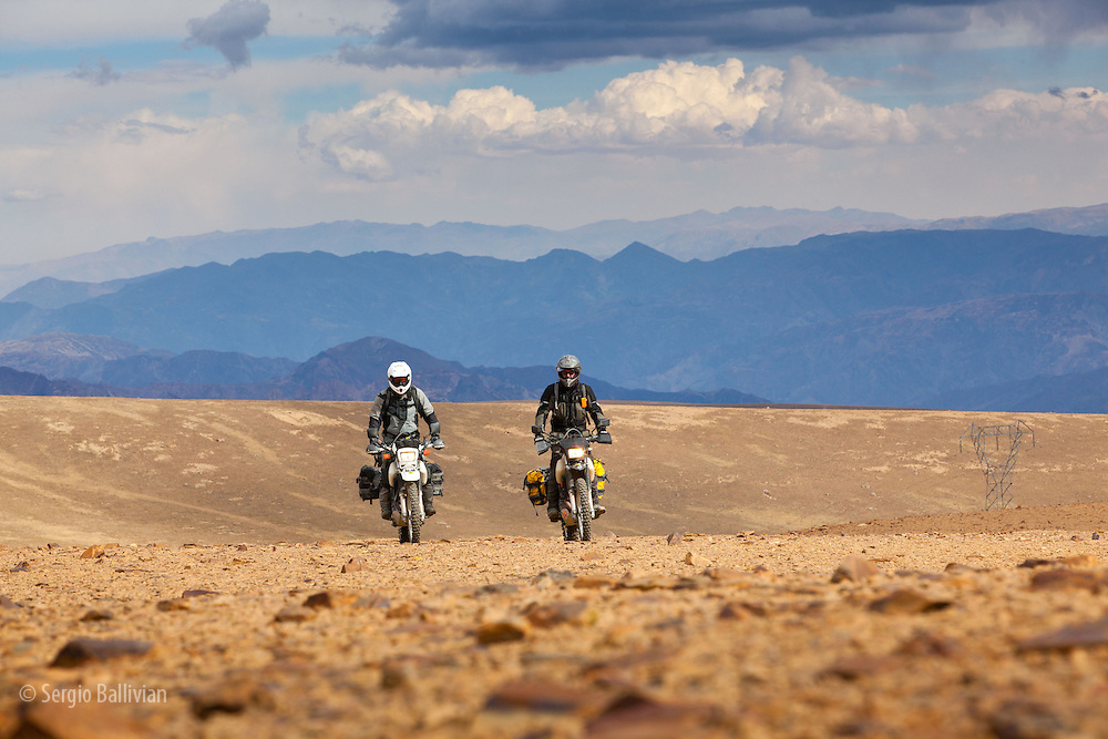 motorcyclist riding at 16,000 ft in the high-altitude Andes of the Cordillera Real near La Paz, Bolivia