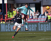1st April 2018, Dens Park, Dundee, Scotland; Scottish Premier League football, Dundee versus Heart of Midlothian; John Souttar of Hearts heads clear from Sofien Moussa of Dundee