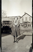 young adult woman standing in village shopping street early 1900s Missouri USA