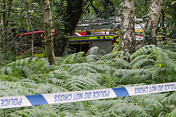 © Licensed to London News Pictures . 01/08/2015 . Cheshire , UK . A fire engine amongst undergrowth near to the crash site . Scene in Oulton Park , Cheshire , where a plane has crashed and one person has died this afternoon (1st August 2015) during the Carfest2015 event . Photo credit : Joel Goodman/LNP